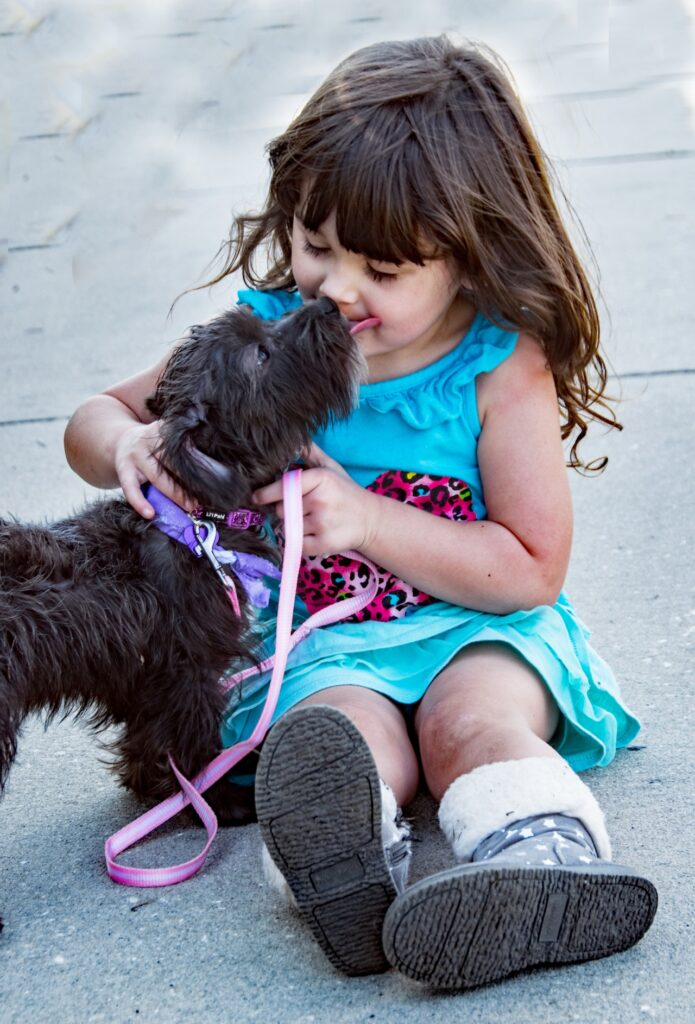Dog with little girl - The Ranch Pet Resort
